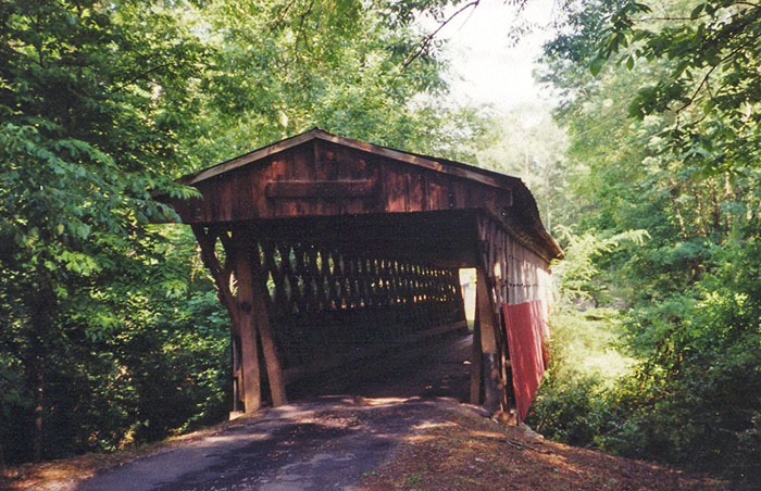 The Easley Covered Bridge, located in Rosa, central Blount County, spans the Dub Branch of the Little Warrior River. It is the smallest remaining covered bridge in Blount County.