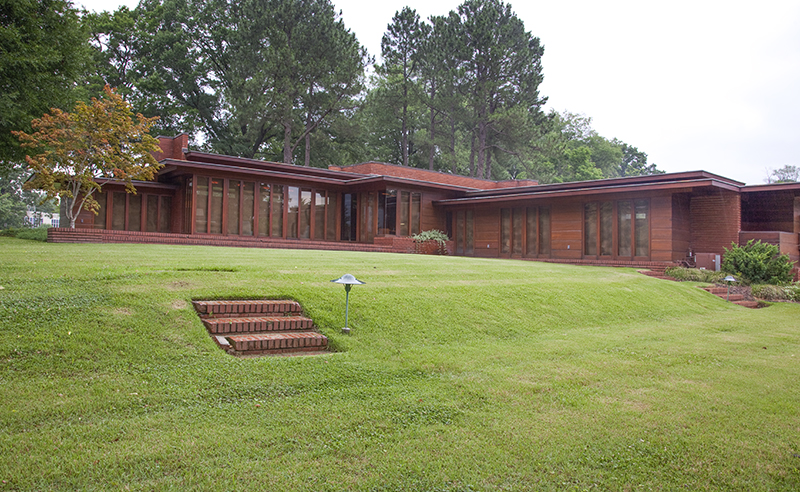 An exterior view of the Rosenbaum House in Florence, Lauderdale County, reveals architect Frank Lloyd Wright's propensity for low-pitched rooflines and walls consisting of unbroken banks of windows.